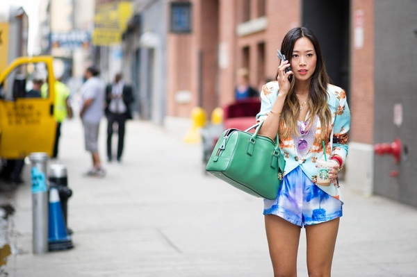 Aimee Song and the NYFW blogger essentials: Westward \ \ Leaning Color Revolution shades, phone, Starbucks, and effortless personal style.