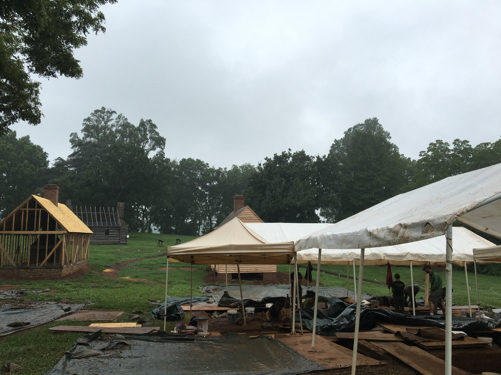 "View of the South Yard, where two structures have been ""ghosted"" (not fully reconstructed), another has been rebuilt, and the team is hard at work in the location of another structure (the South Kitchen)"
