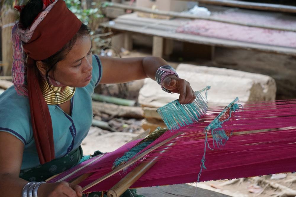 Mu Tae creating the 'Mu Tae Embroidered Wristlet' on a back-strap loom.