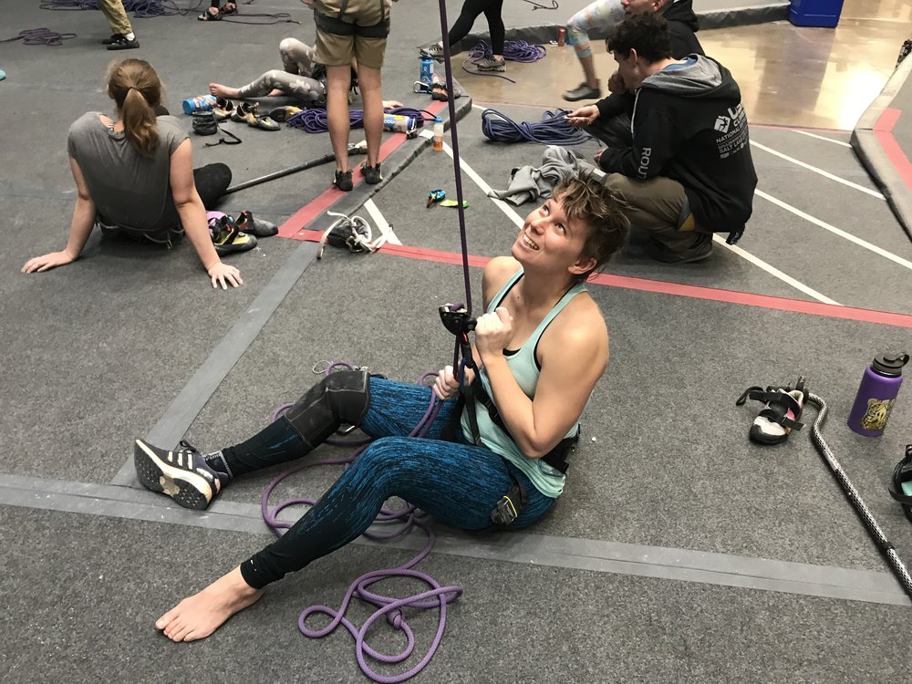 Allison has a chronic pain condition that makes standing to belay untenable. She belays on her butt just fine!