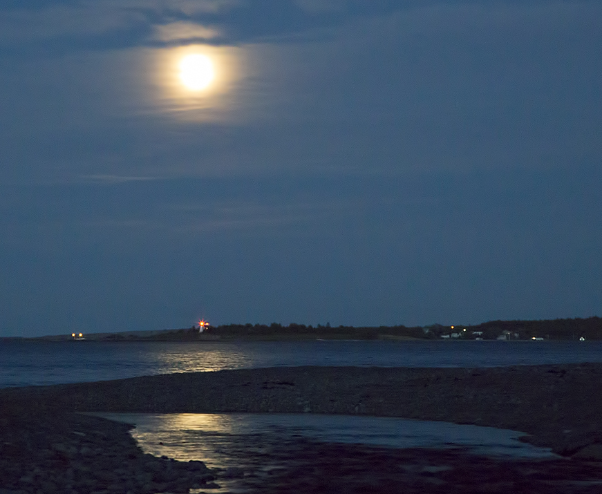 I make my way to the water's edge where the Cape Bretoners wait with their nets.  The beacon from the Gabarus lighthouse is the tiny star just under the moon.