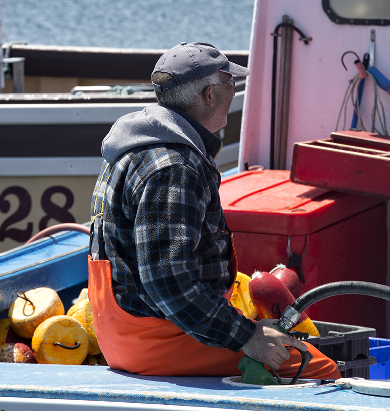 A lobsterman in Main a Dieu refuels his boat.
