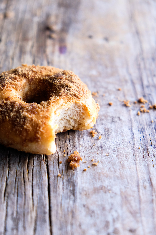 A bite out of a healthy spelt cinnamon doughnut