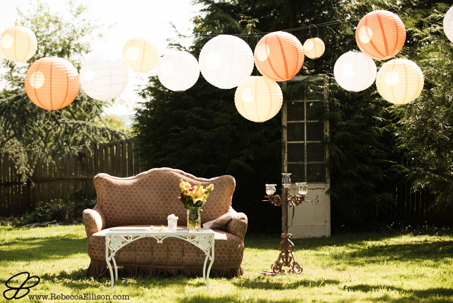 Vintage inspired backyard wedding with living room furniture and orange and yeallow laterns strung
