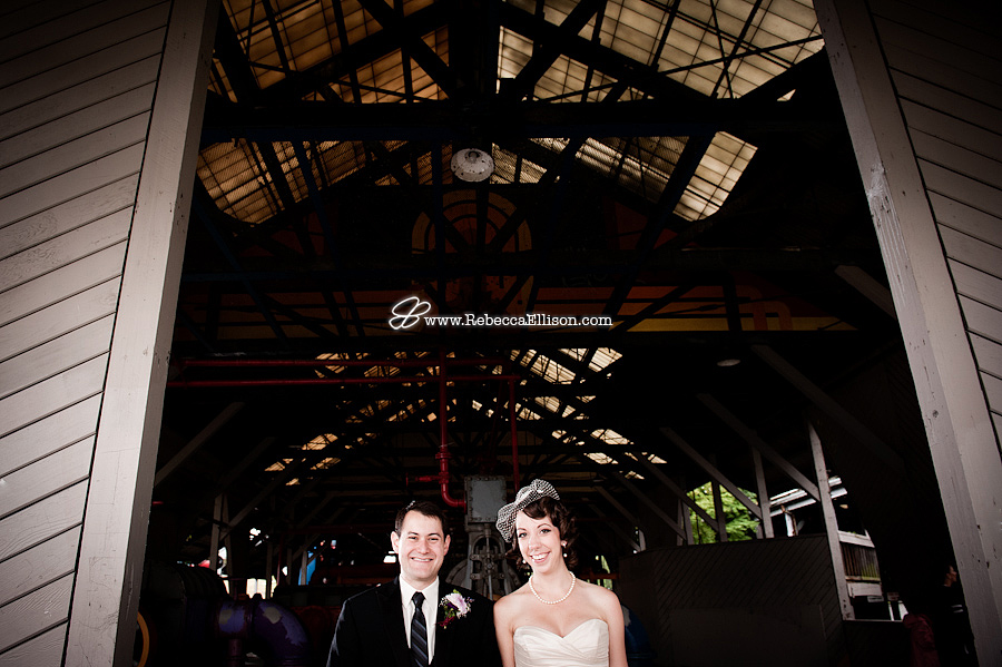 Bride and groom get away from the rain at Gasworks Park wedding in seattle