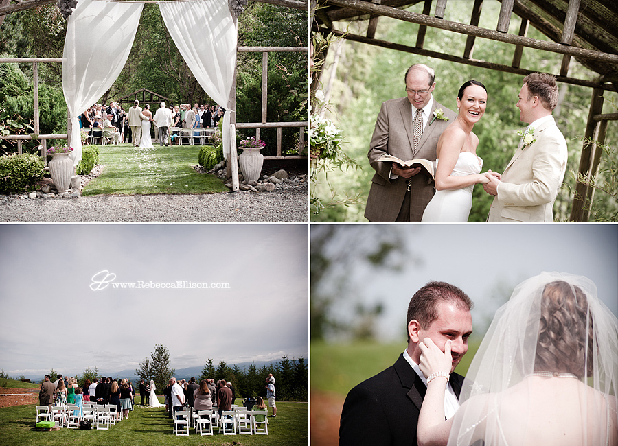 bride wipes tear from grooms eyes during wedding ceremony in Seattle