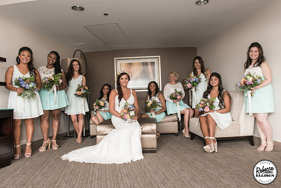 Bridal Party portrait featuring spring colored flowers and light blue and white bridesmaids dresses photographed by Seattle wedding photographer Rebecca Ellison