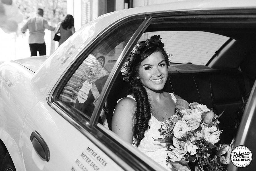 Black and white portraits of a Bride in a taxi on the way to her Rainier Rooftop Park wedding photographed by Seattle wedding photographer Rebecca Ellison