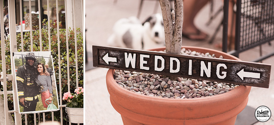 A vintage sign and a photo of the bride and groom point the way for wedding guests to a Rainier Rooftop Park wedding