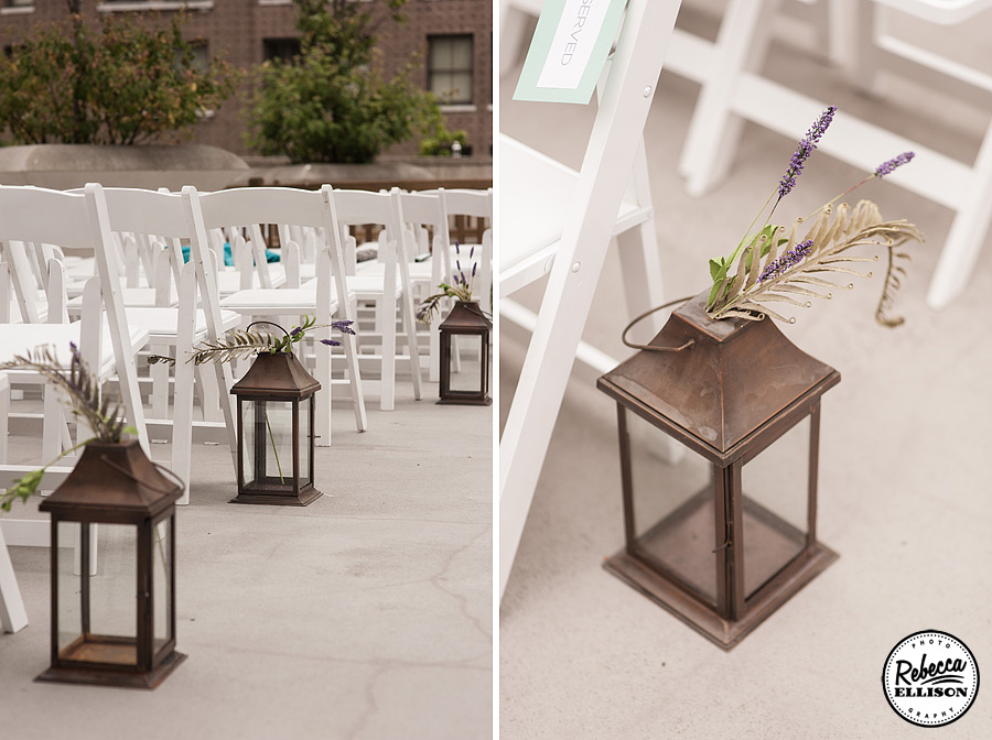 Bronze lanterns filled with lavender line the aisle at a Rainier Rooftop Park wedding photographed by Rebecca Ellison Photography
