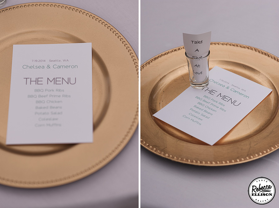 "Wedding reception details featuring gold plate chargers, menus and a shot glass ""Take a Shot at Love"" photographed by Rebecca Ellison Photography"