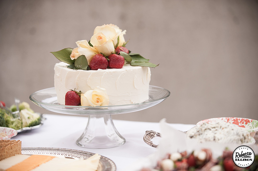 Wedding cake with white roses and strawberries photographed by Seattle wedding photographer Rebecca Ellison