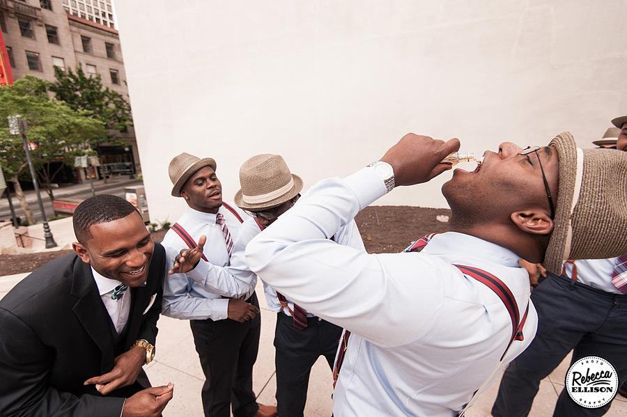 Groomsmen celebrate before a Rainier Rooftop Park wedding photographed by Seattle wedding photographer Rebecca Ellison