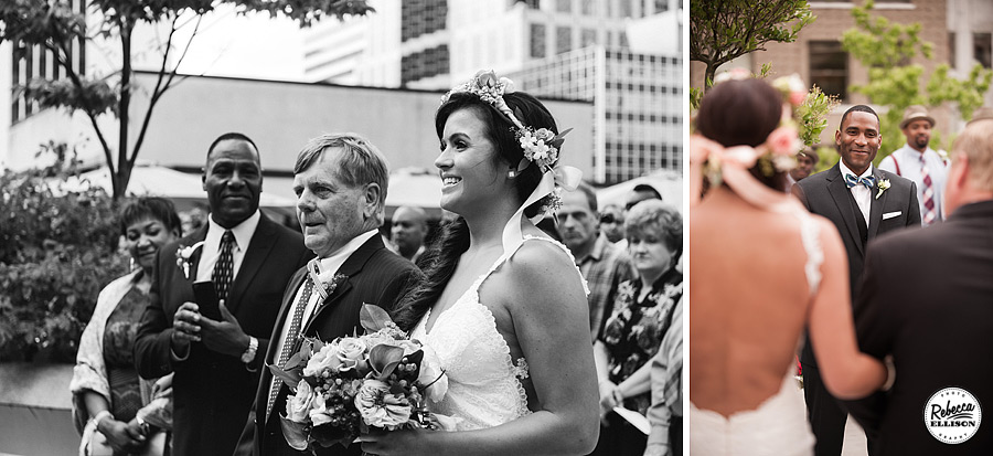 Bride walks down the aisle at a Rainier Rooftop Park wedding featuring a white backless wedding down and a crown of flowers photographed by Rebecca Ellison Photography
