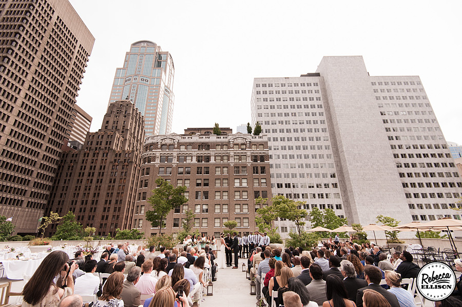 Wedding ceremony at Rainier Rooftop Park with the Seattle Skyline as a backdrop photographed by Seattle wedding photographer Rebecca Ellison