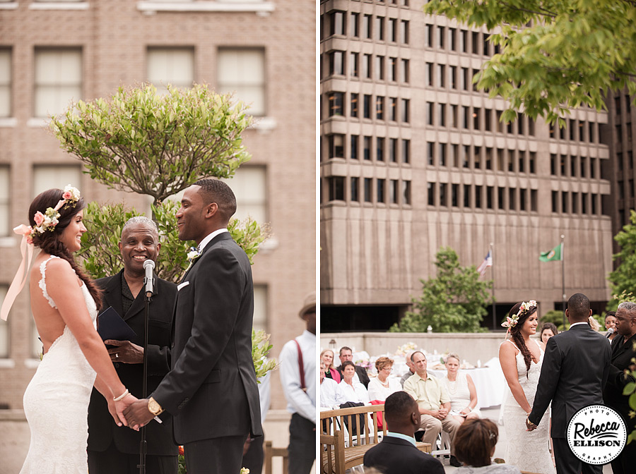 Rainier Rooftop Park wedding ceremony featuring a white backless wedding dress and crown of flowers photographed by Seattle wedding photographer Rebecca Ellison