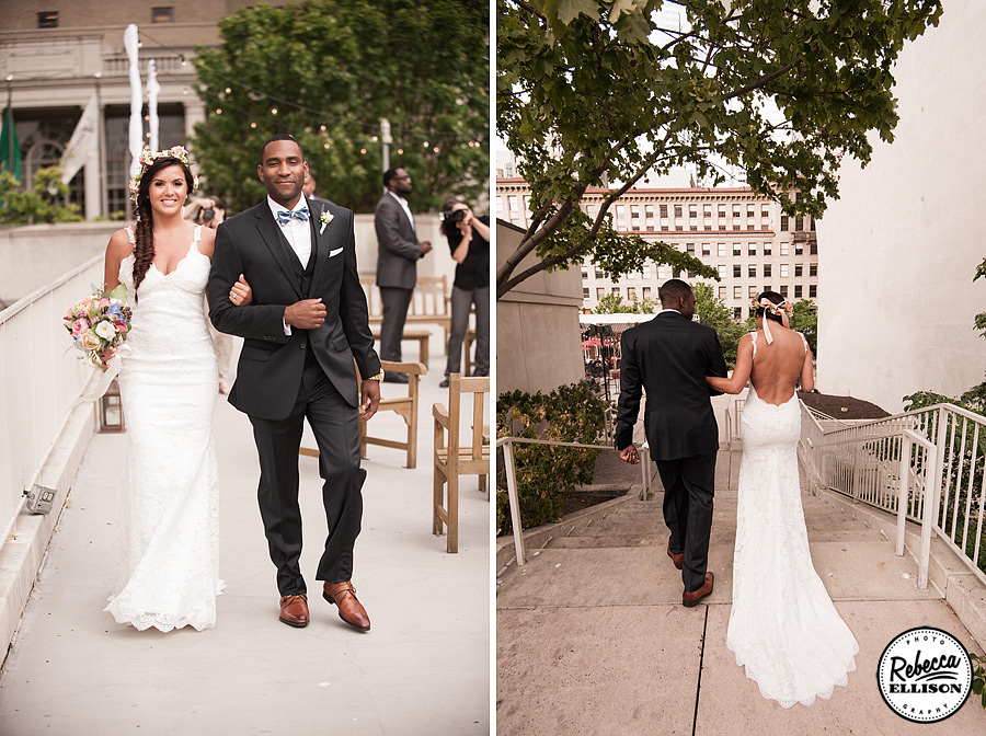 Bride and groom after their Rainier Rooftop Park wedding ceremony featuring a white lace backless wedding dress, fishtail braid and a crown of flowers photographed by Seattle wedding photographer Rebecca Ellison