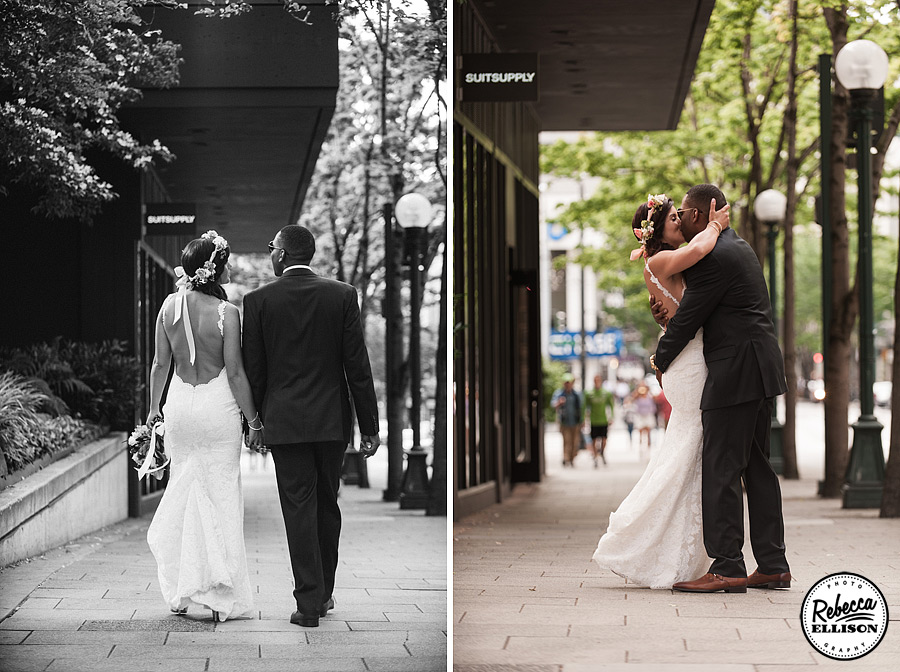 Bride and groom stroll through downtown Seattle after their wedding featuring a white backless Katie May wedding dress and a crown of flowers photographed by Seattle wedding photographer Rebecca Ellison