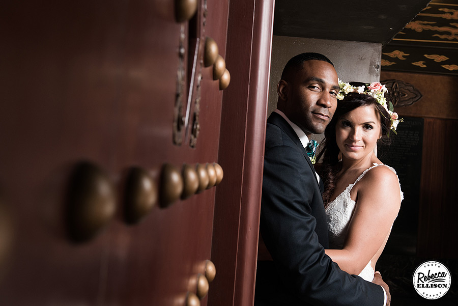 Bride and groom in front of ornate doors photographed by Seattle wedding photographer Rebecca Ellison