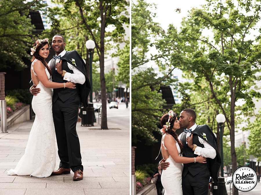 Bride and groom downtown Seattle outdoor wedding portraits featuring a white lace Katie May backless wedding dress and a crown of flowers photographed by Rebecca Ellison Photography