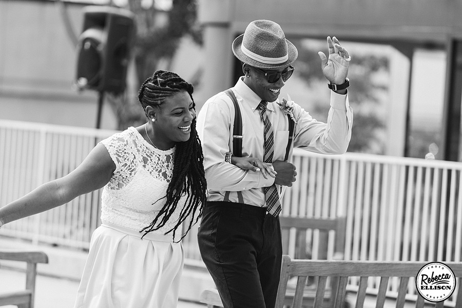 Black and white photo of wedding party celebrating at a Rainier Rooftop Park wedding photographed by Rebecca Ellison Photography