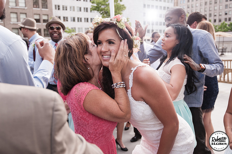 Guests congratulate the bride at a downtown Seattle outdoor wedding reception photography by Rebecca Ellison