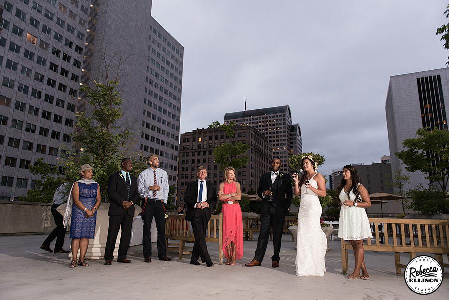 Wedding toasts against the Seattle Skyline photographed by Seattle wedding photographer Rebecca Ellison