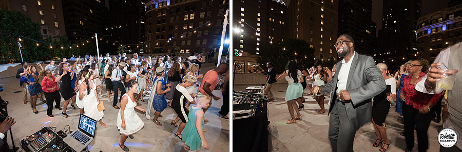 Wedding guests dance with the Seattle skyline at night photographed by Rebecca Ellison Photography