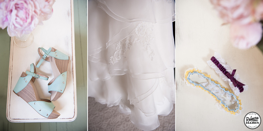 Bridal details light blue wedge sandals, a layered lace skirt and lace garter on top of a vintage table photographed by Rebecca Ellison photography