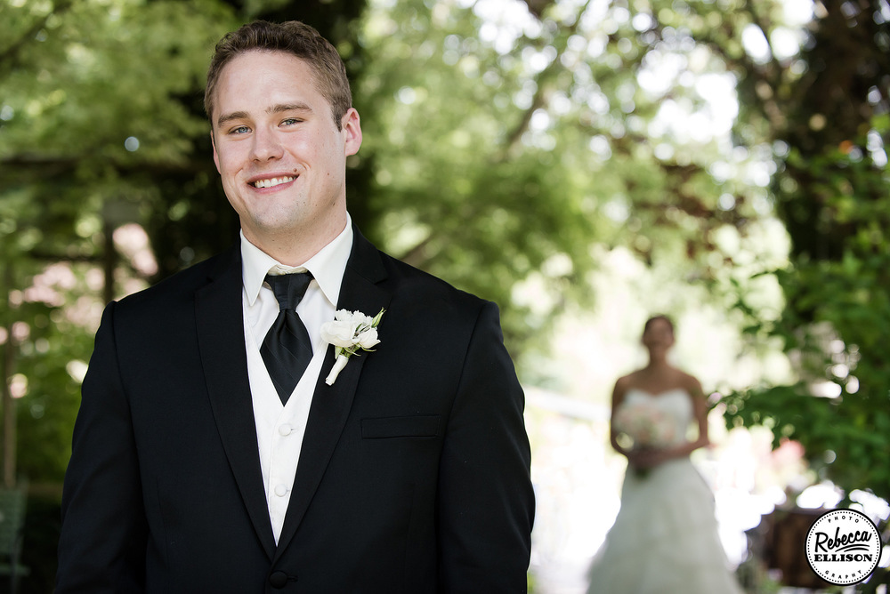Groom waits for his first look at his bride during an outdoor wedding portrait session photography by Rebecca Ellison