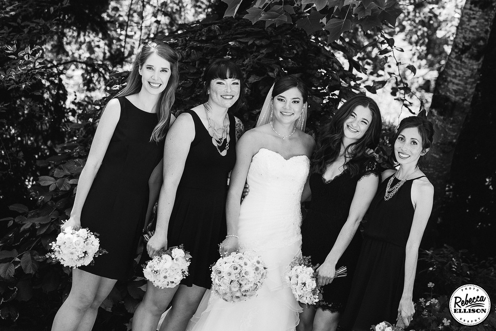 Black and white outdoor bridal party portraits featuring black bridesmaids dresses photographed by Rebecca Ellison Photography