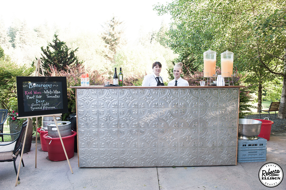Hammered metal and chalkboard bar menu at an outdoor garden wedding