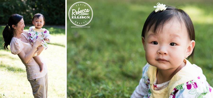 1 year old girl and her mother play in the grass during an outdoor photo session with Bellevue baby photographer Rebecca Ellison