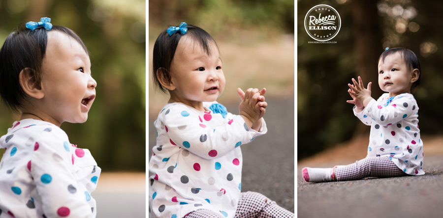 1 year old girl claps her hands during her first year portrait session by Bellevue baby photographer Rebecca Ellison