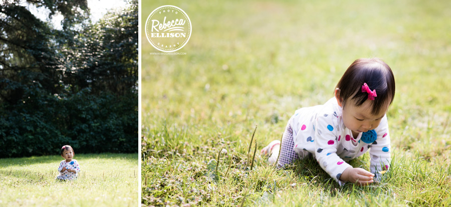 Crawling in the grass during a 1 year old portrait session photographed by bellevue baby photographer Rebecca Ellison