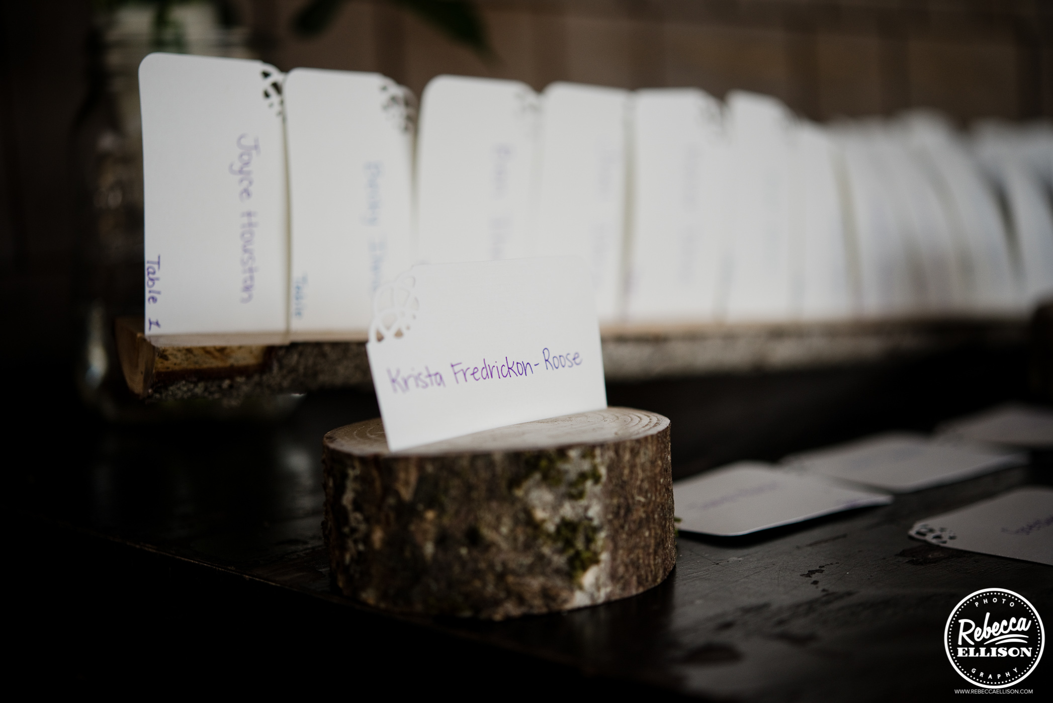 creative place cards for weddings - cards placed in wood