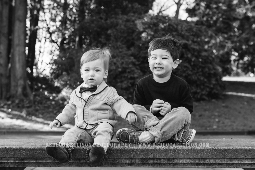 brothers sit on benches together