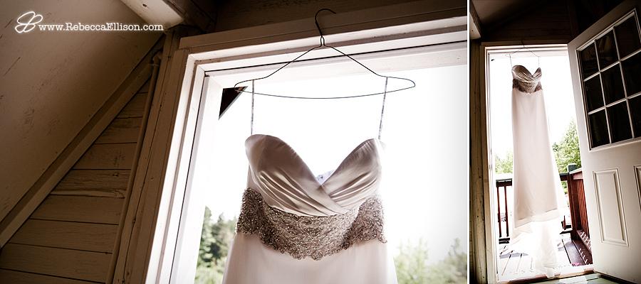 a beautiful wedding dress hanging in the doorway
