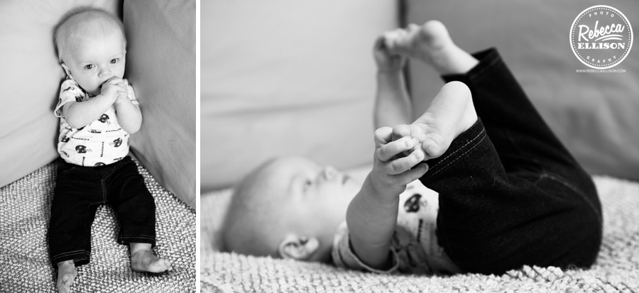 Black and white portraits of a baby playing with his toes photographed by Rebecca Ellison photography