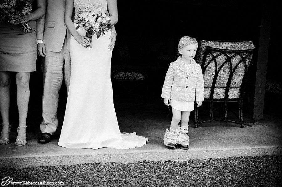 ringbearer interupts bridal party photo with pants around ankles