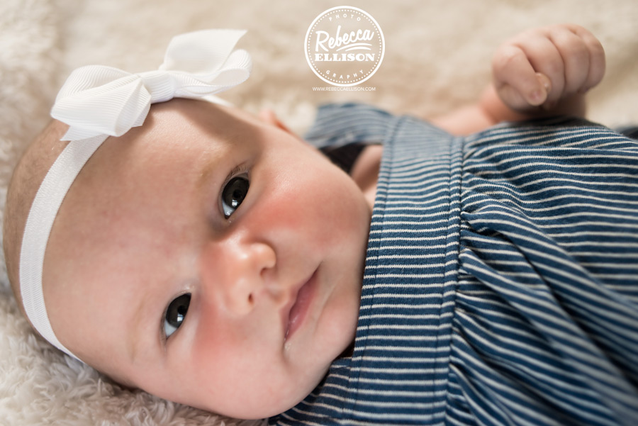 Close up of an 8 week old baby girl photographed by Seattle newborn photographer Rebecca Ellison