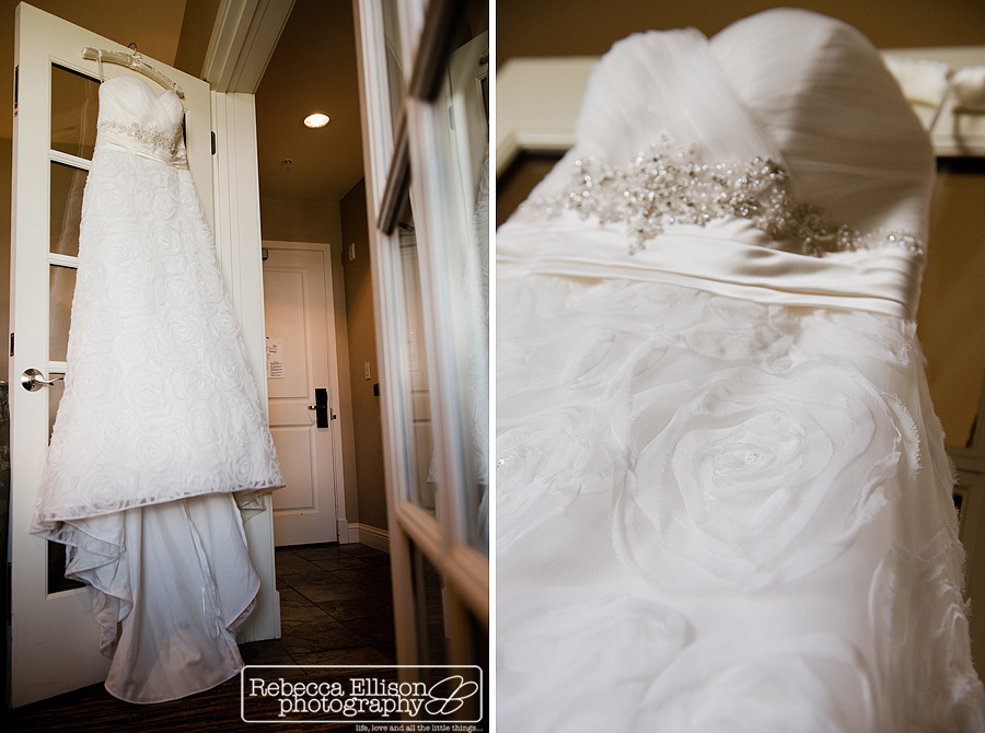 wedding dress hangs in room at Alderbrook resort wedding