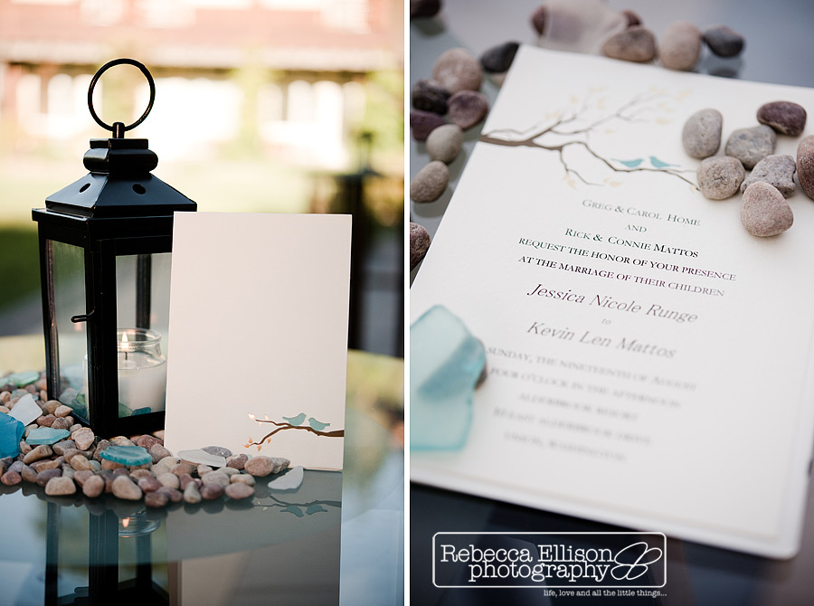 wedding invitation detail with branch and two birds sitting in river rocks