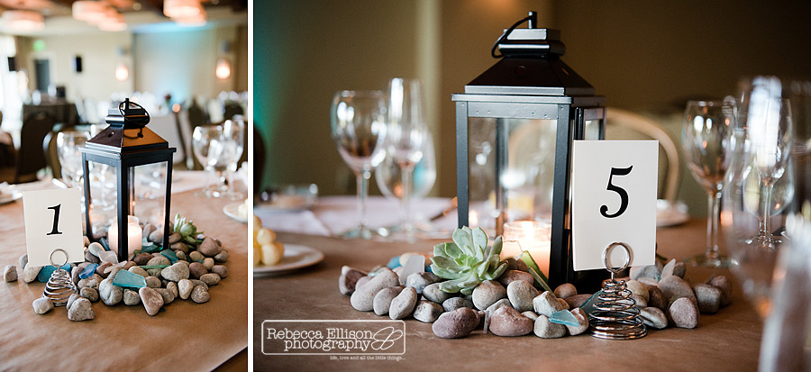 black candle lantern wedding centerpieces with river rocks and river glass
