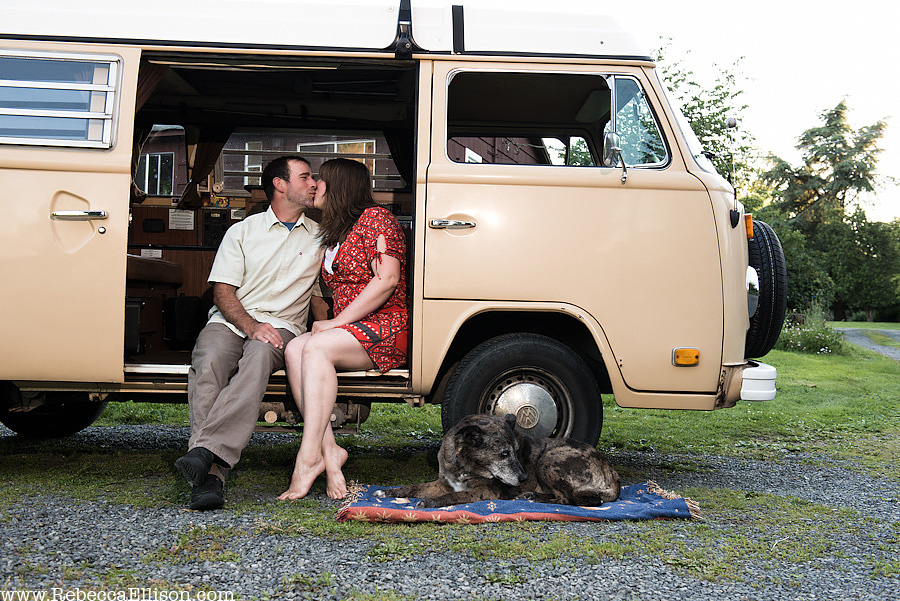 outdoor-engagement-session- couple sitting in old vw transporter bus