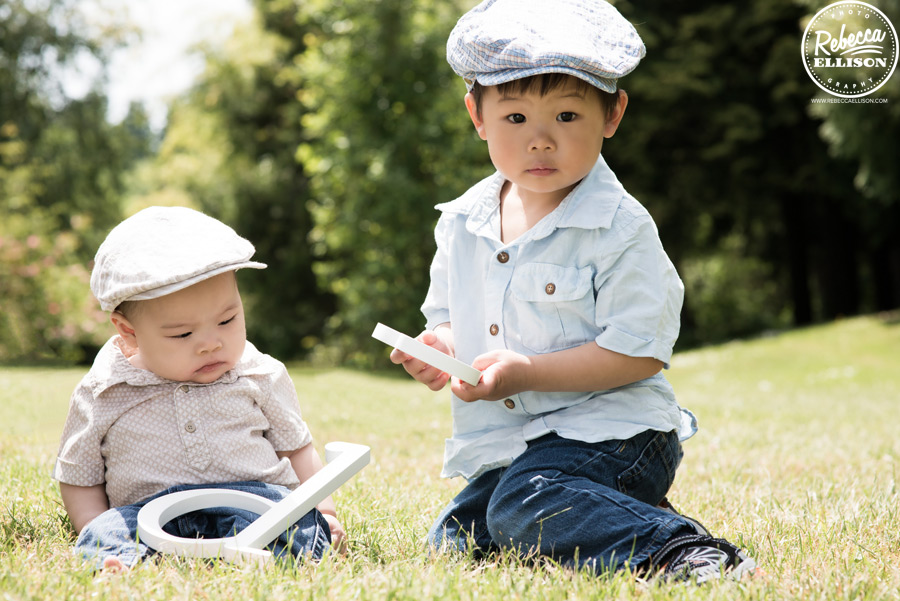 Brothers in matching hats during an outdoor family portrait session by Rebecca Ellison photography