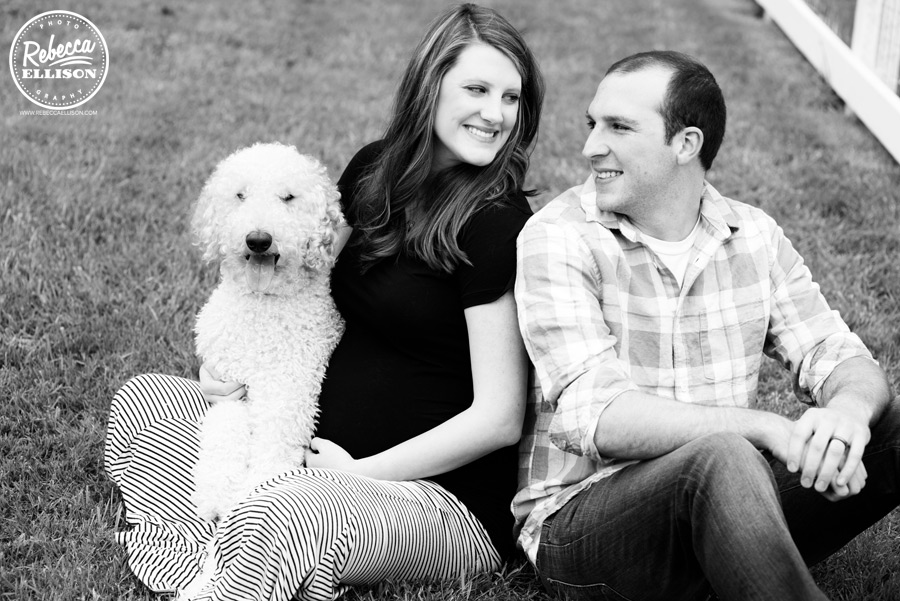 An expectant couple and their dog during outdoor maternity portraits by Woodinville maternity photographer Rebecca Ellison