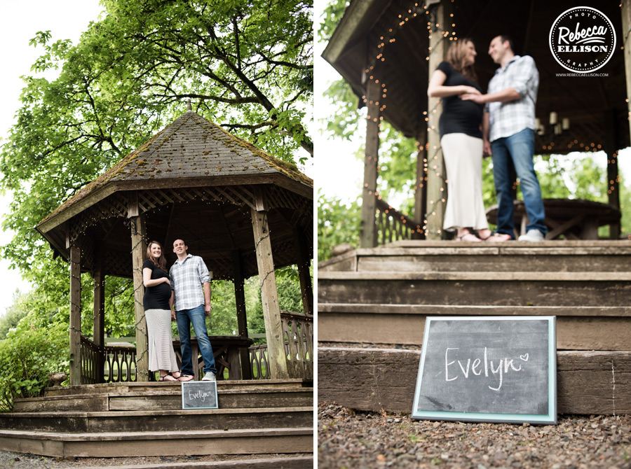 Delille Cellars maternity portraits featuring a wooden gazebo and chalkboard baby name photographed by Woodinville maternity photographer Rebecca Ellison