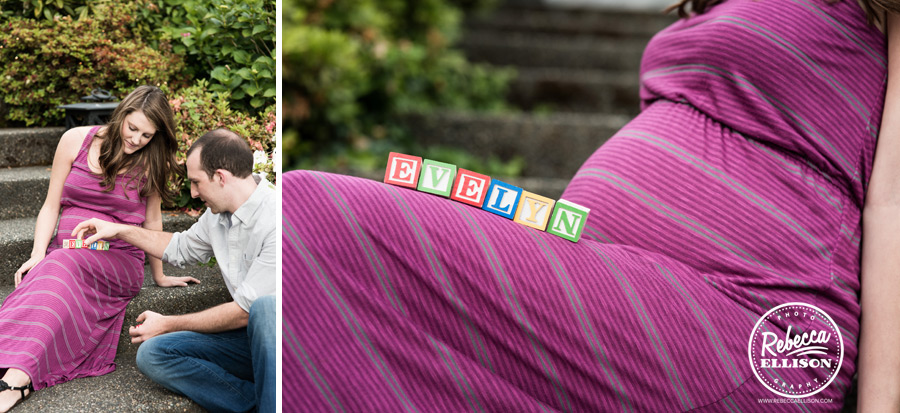 Toy wooden blocks spell the baby's name with baby bump in the background during a woodinville maternity portrait session with Rebecca Ellison Photography