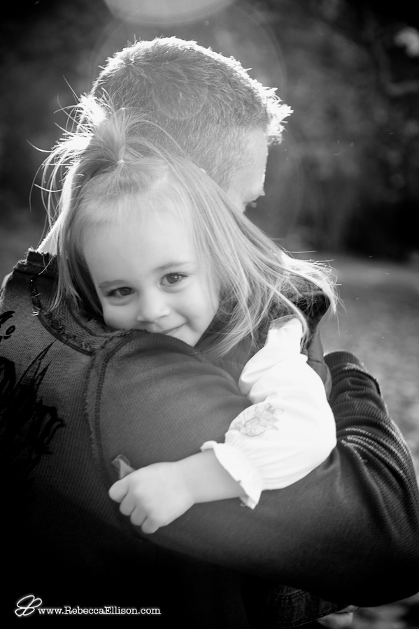black and white of girl hugging dad